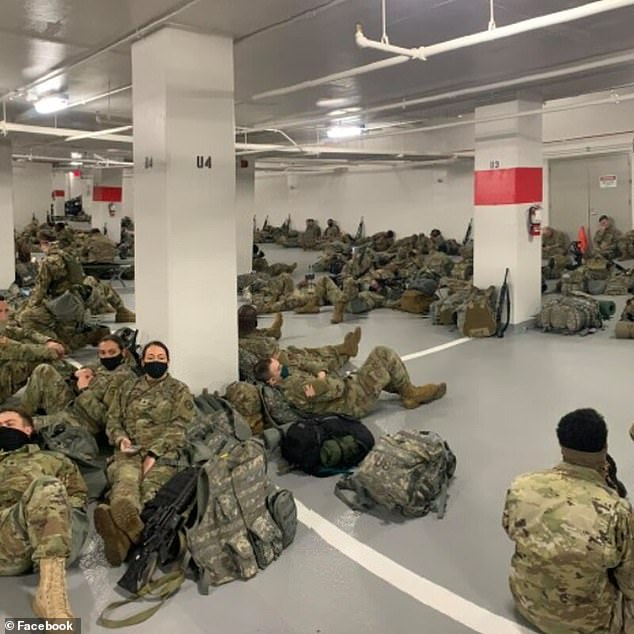 Pictures show Guardsmen sleeping on the floor of the packed parking lot Thursday. It is not known why the troops were moved from Capitol buildings