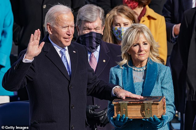 Biden is pictured being sworn in on a family bible held by his wife, First Lady Jill Biden