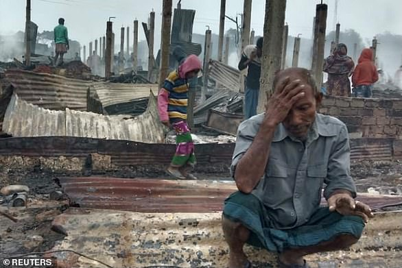 A Rohingya man reacts after a fire burned houses of the Nayapara refugee camp in Cox's Bazar, Bangladesh, January 14, 2021.