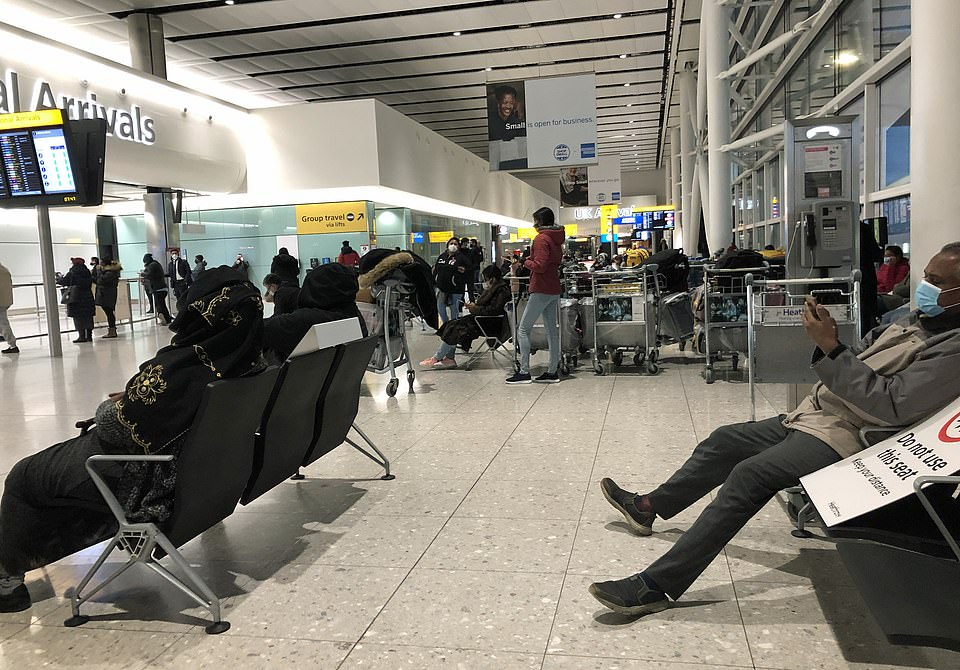 Passengers wait at  Heathrow Airport today as ministers mull even tighter rules