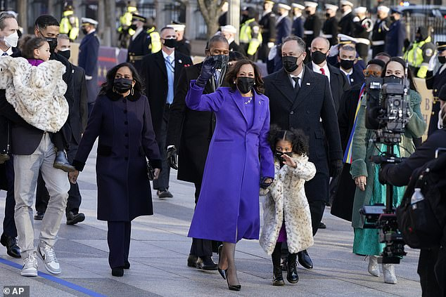 Kamala is pictured holding Amara's hand on inauguration day as Meena (right) walks alongside