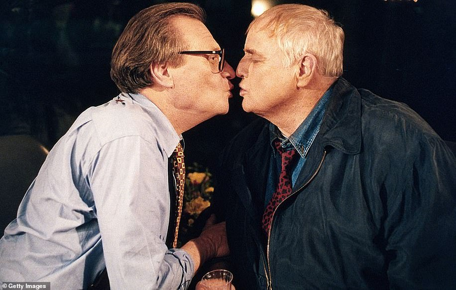 "King and Brando famously shared an on-air kiss during the taping of ""The Larry King Show' taped at Brando's house in Coldwater Canyon on October 7, 1994"