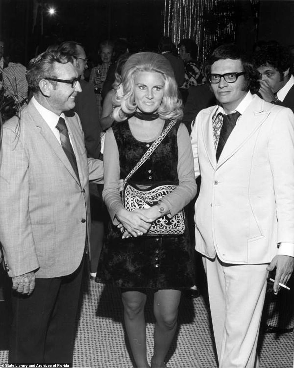 Larry King (right) stands with Playboy Bunny Alene Akins, whom he married twice from 1961 to 1963 and again from 1967-1972. The couple had two children who preceded King in death after passing away within the same week in August 2020. King was married eight times to seven different women. 'I love being in love,' he told Anderson Cooper in 2009