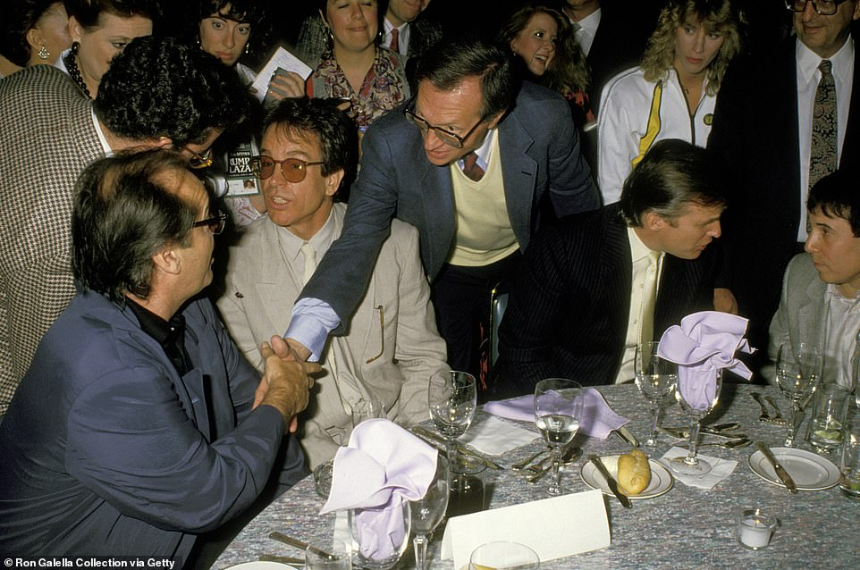 King introduces himself to Jack Nicholson at a table with Warren Beatty, Donald Trump and Paul Simon. When asked 'who is the worst guest he ever interviewed?' King responded:  'Easy, Robert Mitchum. I loved the guy. He was a great actor, and we were friends. But the minute I got him on my show, he put my feet to the fire. It was a series of yups, nopes and maybes'