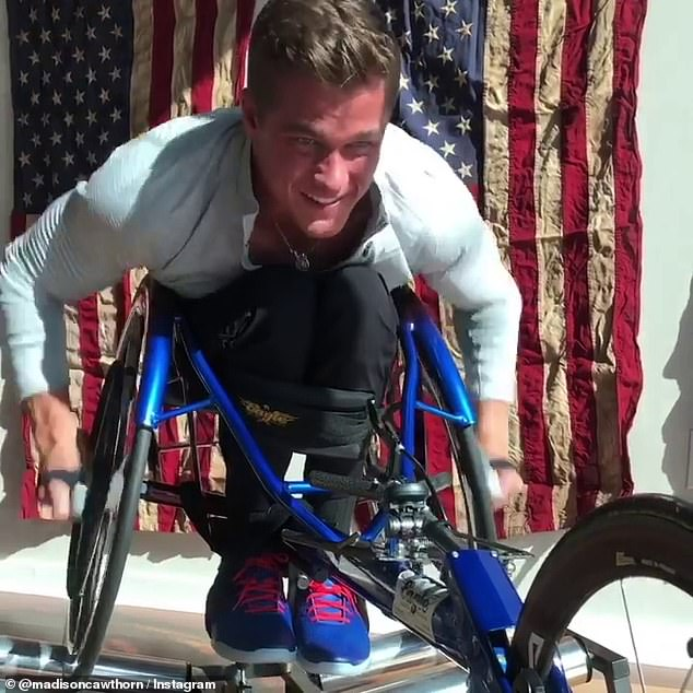 Cawthorn, who was paralyzed from the waist down in a 2014 car crash, previously claimed on social media he was training to compete in the 2020 Tokyo Paralympic Games.In a February 2019 post (above), Cawthorn said he was 'pursuing this world record'
