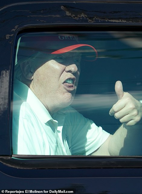 At one point, he gave his supporters a thumbs up