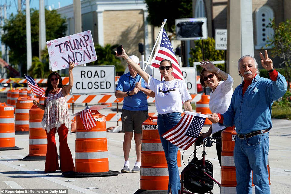 Some Trump fans were waving American flags as well as signs that read: 'Still My President!' and 'Trump Won!'