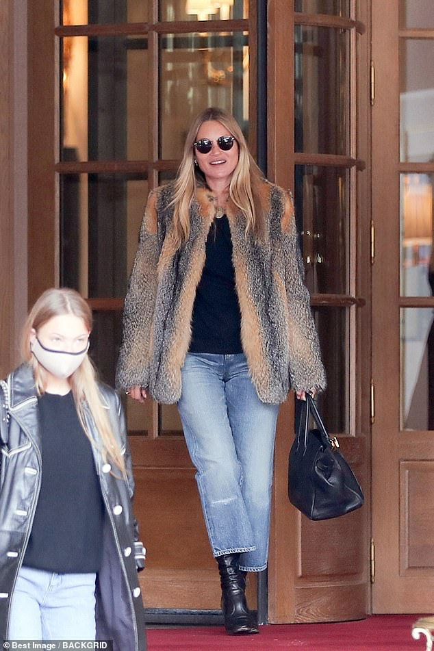 Living it up: Kate Moss jetted into curfew-hit Paris for her 47th birthday weekend where she stayed at the Ritz with her boyfriend Nikolai von Bismarck and daughter Lila Grace (pictured)