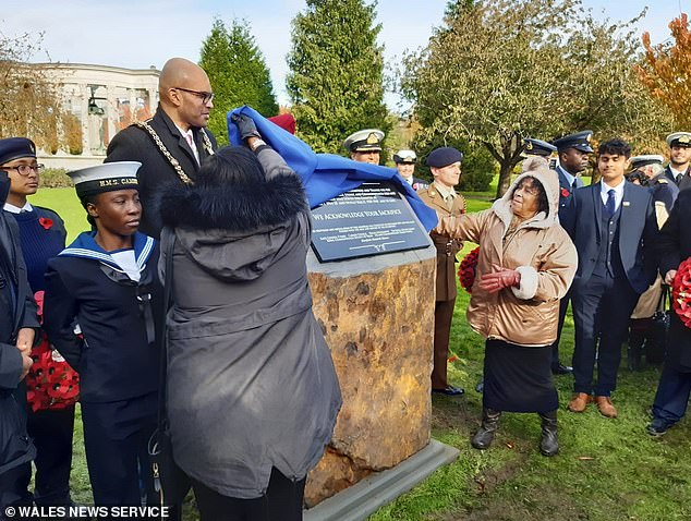 Pictured: The memorial for black and ethnic minority heroes from the world wars was unveiled in Cathays Park, Cardiff, in 2019 after community groups launched a campaign for a tribute