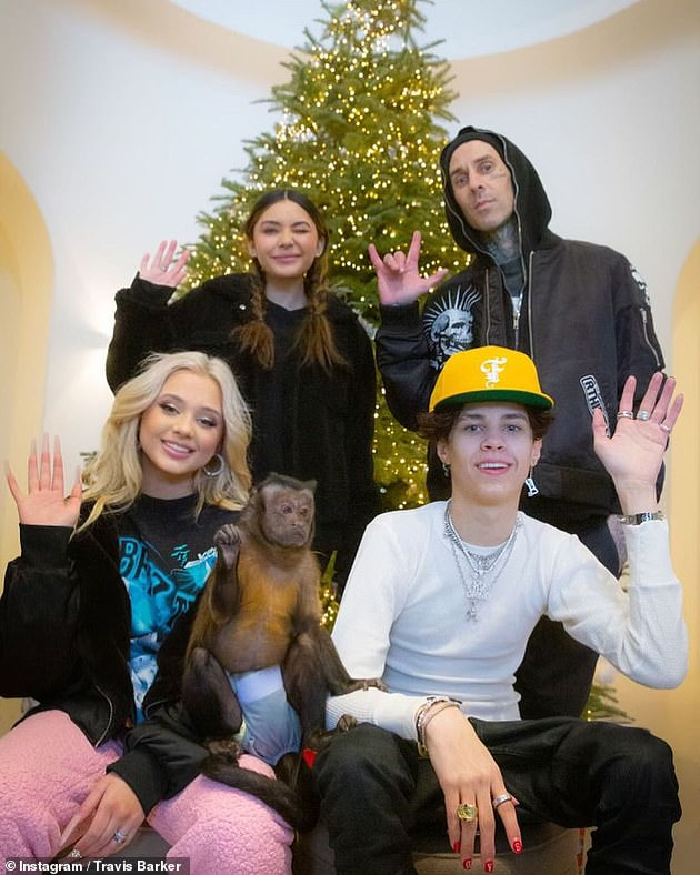 Family first: The rocker shares Landon, 17, Alabama, 15, and stepdaughter Atiana, 21 (pictured together), with his ex Shanna Moakler, whom he was married to from 2004 until 2008