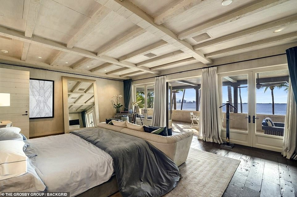 Collins immediately put the luxury mansion on the market and has now received a pending sale for the $40million property, according to the listing. Pictured: The master bedroom has custom walk-in closets and a private terrace looking out to water