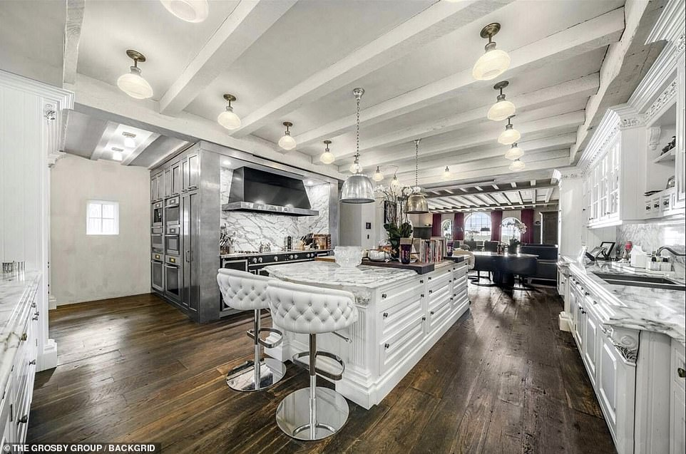 Yet the Genesis rocker never plans to set foot in the sprawling waterfront property again, DailyMail.com has previously revealed. Pictured: The stunning white kitchen, fitted with white marble counters and a large oven.