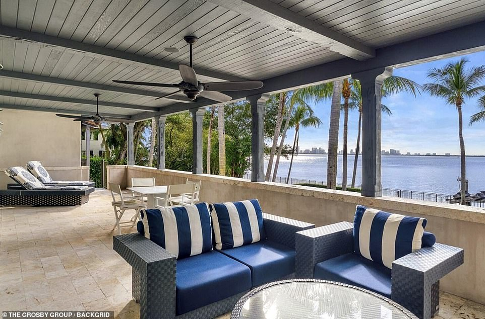 The Spanish-style home offers spectacular views of the Miami skyline and features a large pool and spa, as well as arched arcades and a two-story rotunda foyer