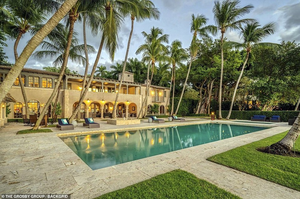 The luxurious property sits on a 1.21 acre lot and on it the main house occupies 11,039 square feet of living space. It has 6 bedrooms and 8 and half bathrooms