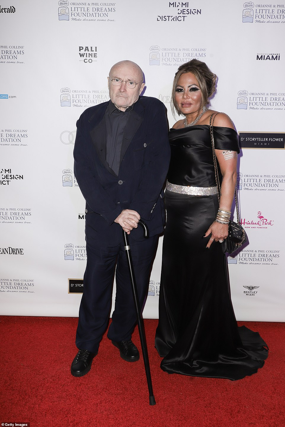 Phil Collins and his ex Orianne are seen above at an event in Miami, Florida, in November 2019