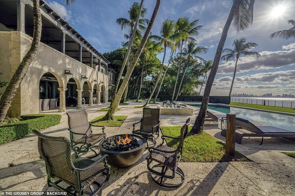 The stunning property also features a fire pit, water fountain, a summer kitchen, an acabana and a garage for three cars. It also has 184 feet of private water frontage and its own private dock