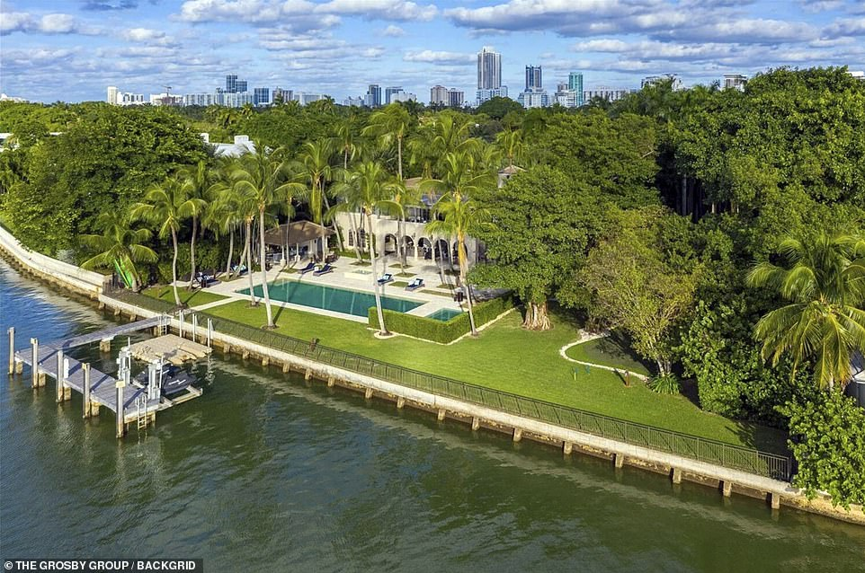 The luxurious property sits on a 1.21 acre lot and features a private jetty where the new owners can go for a swim or sail