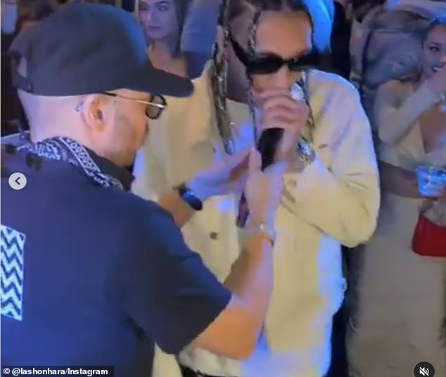 Packed: At least 150 maskless revelers partied at an extravagant birthday bash on Miami's Star Island on Saturday with star guests like Post Malone, Scott Disick and Tyga. Video on social media show guests maskless, dancing together and ignoring social distancing at the bash where Tyga performed. Tyga pictured with the microphone above