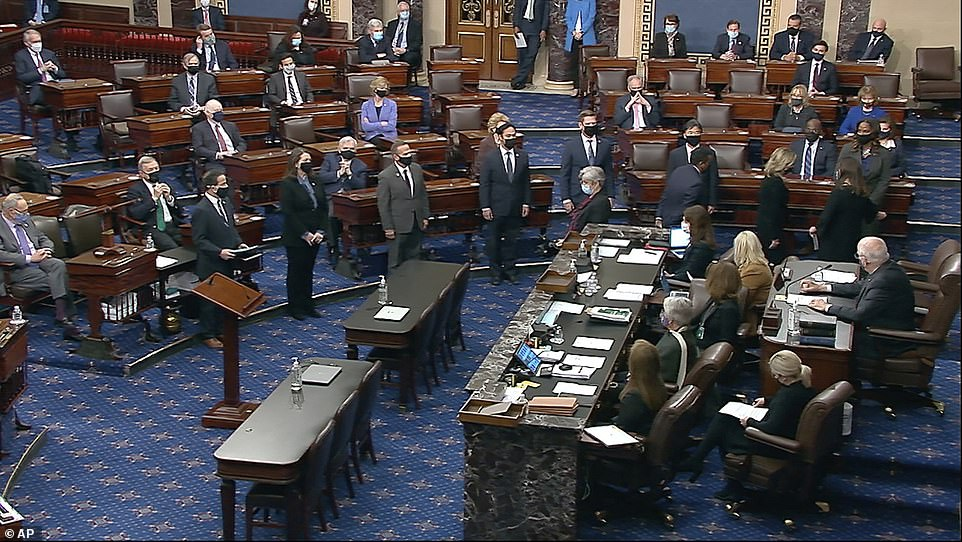 Ready: The House impeachment managers are announced as being present by Patrick Leahy, the Vermont senator who will preside over the trial