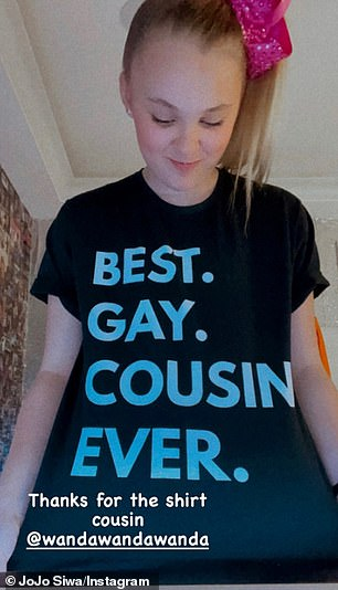 JoJo pictured Friday wearing her 'best gay cousin ever' T-shirt from her cousin