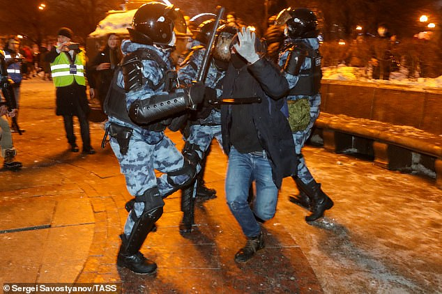 Riot police officers detain a participant in an unauthorized rally in support of Russian opposition activist Alexei Navalny by the Moscow Circus