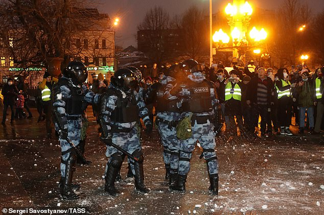Riot police officers guard the area during an unauthorized rally in support of Russian opposition activist Alexei Navalny