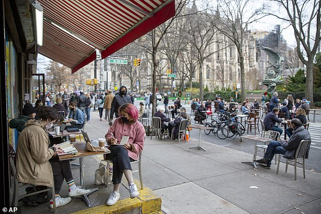 Indoor dining was banned in NYC in mid-December just two months after it was finally allowed to resume. Pictured above is outdoor dining in Manhattan