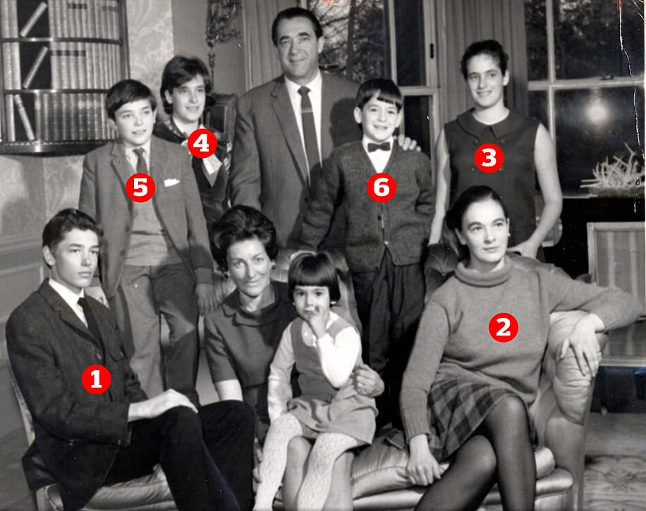 Robert Maxwell (back row, centre) pictured with his wife Betty (sat with youngest daughter Ghislaine on her knee) and seven of their eight children at home in Headington Hill Hall, Oxford. When this photo was taken Ian (5) was 11 years old and attending preparatory school, while Isabel, then 17 (4) was at grammar school with their sister Christine (3), and youngest son Kevin, 8, (6) was at preparatory school. Second oldest son Philip, (1), had entered his second undergraduate yer at Balliol College, Oxford, while Anne (2) was also studying at the university, but at St Hugh's College.