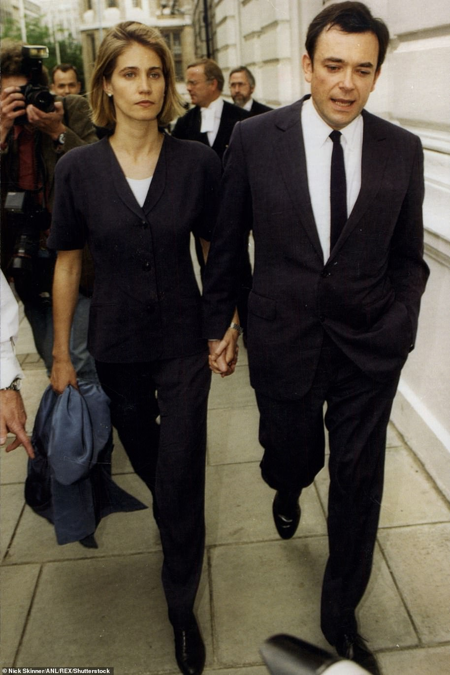 Ian pictured with his wife Laura at court on the first day of his trial, where he and his brother were accused of taking at least £122million worth of pension funds