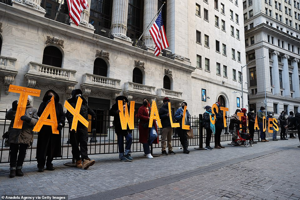 Protesters gathered outside the New York Stock Exchange on Thursday