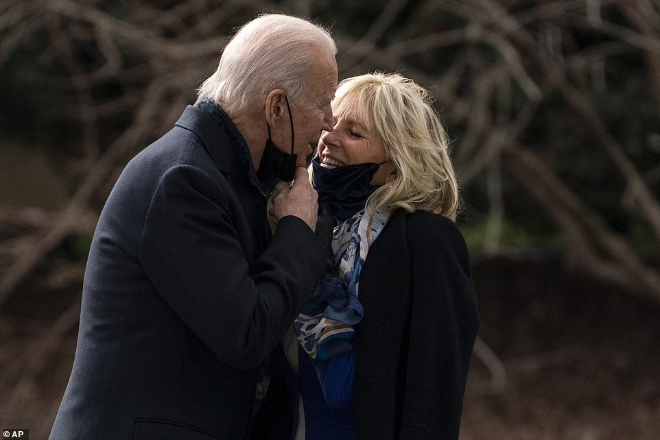 The Bidens had to pull down their face masks to kiss