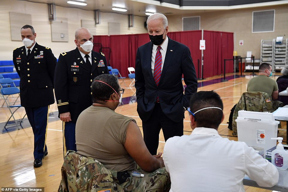 President Biden speaks with service members in the vaccine center at Walter Reed