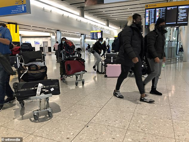 Passengers arrive at London Heathrow Airport this morning with the last few flights coming back to the UK from Dubai