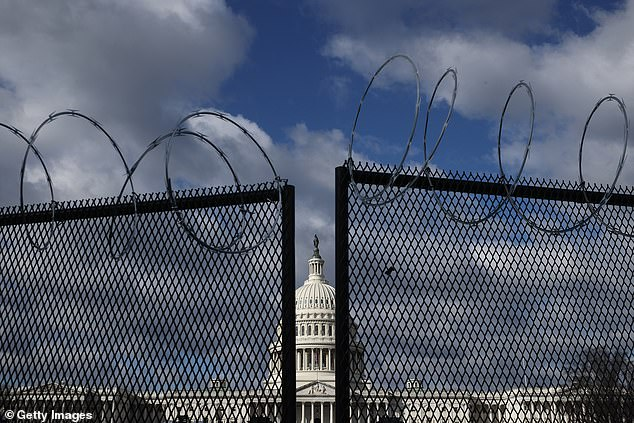 An eight-foot tall steel fence topped with concertina razor wire was erected around the US Capitol following the violent siege on January 6