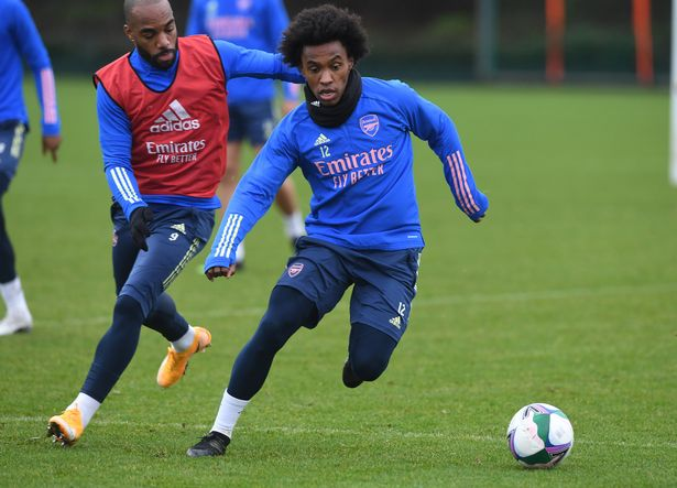 Alexandre Lacazette and Willian of Arsenal during a training session at London Colney