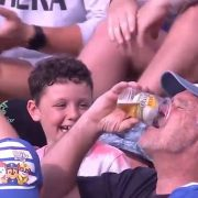 C'mon Aussie: Cricket fan catches ball in his beer cup at a BBL match and tries to drink it