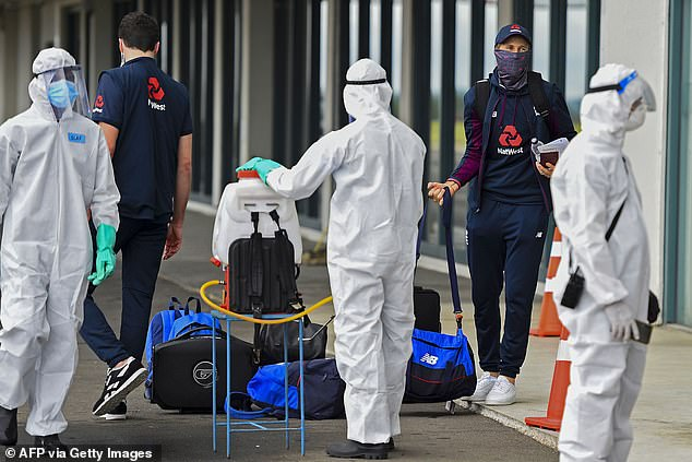 The England cricket team touched down in Sri Lanka on Sunday to be greeted by officials in full hazmat suits who sprayed their clothes and luggage with disinfectant