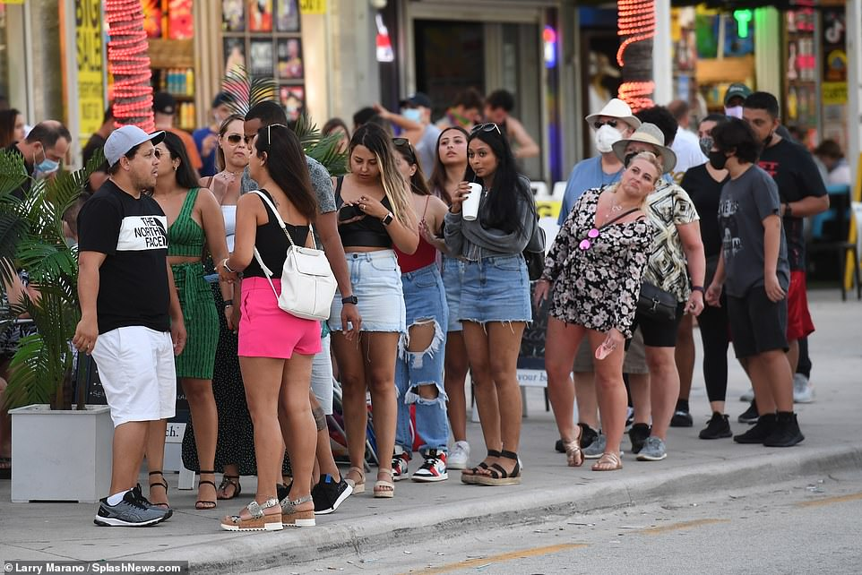 Florida crowds party despite Covid cases rising above 10,000 for fifth consecutive day