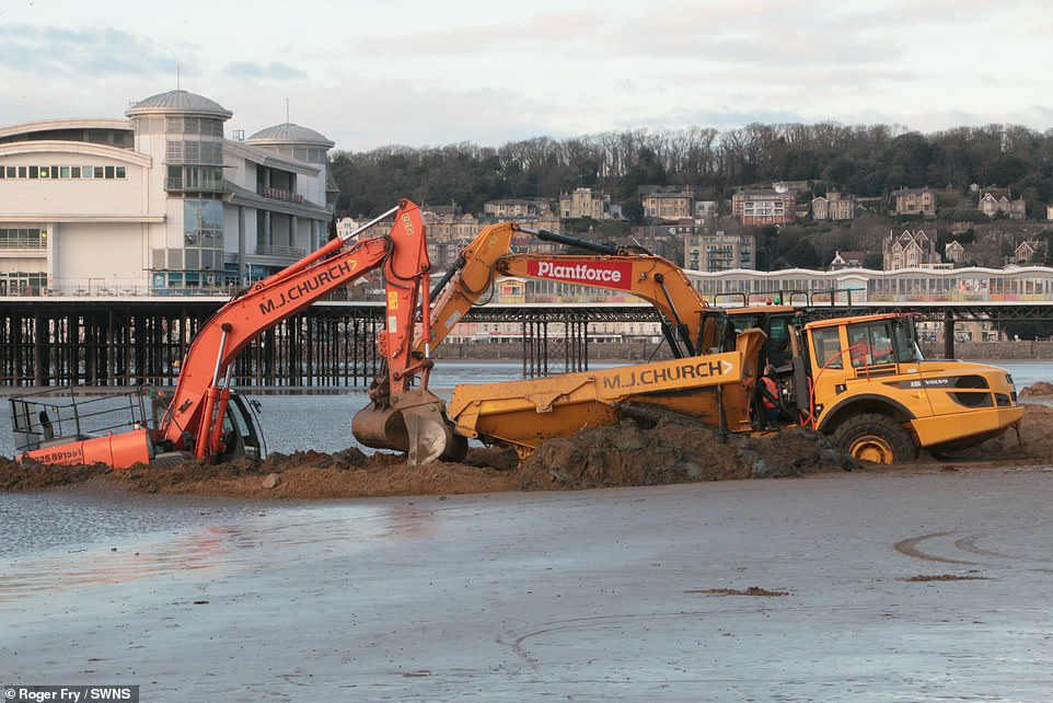 Got that sinking feeling! Rescue mission fails as tide swamps digger that got stuck on a beach