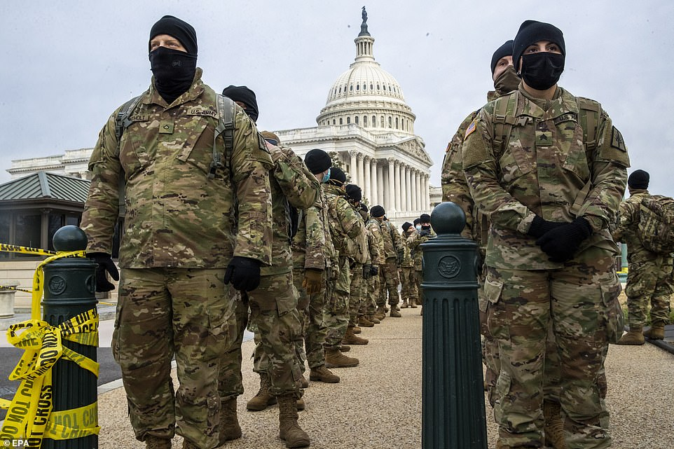With Joe Biden's inauguration fast approaching in nine days, Washington, DC, and cities around the US are bracing for violent protests similar to that which left five people dead at the Capitol last week. Pictured:Members of the New York National Guard line up on the East Front of the Capitol on Monday morning