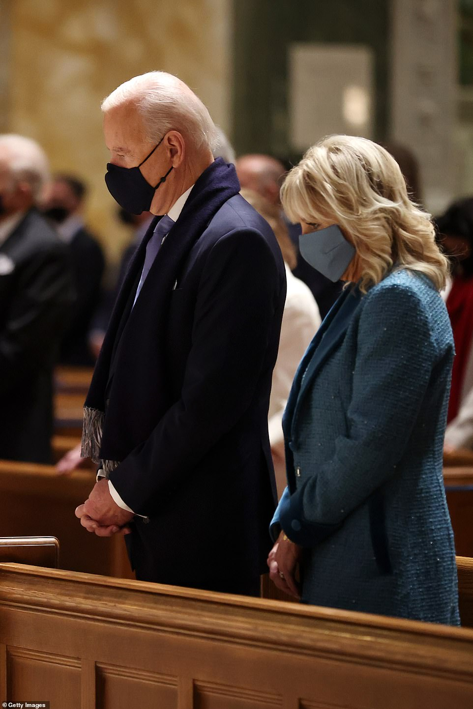 Joe Biden shows where the real power lies as he attends mass with leaders from BOTH parties