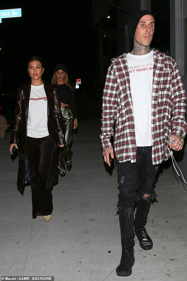 Kourtney Kardashian dating long time friend Travis Barker 'for month or two' amid Palm Springs trip