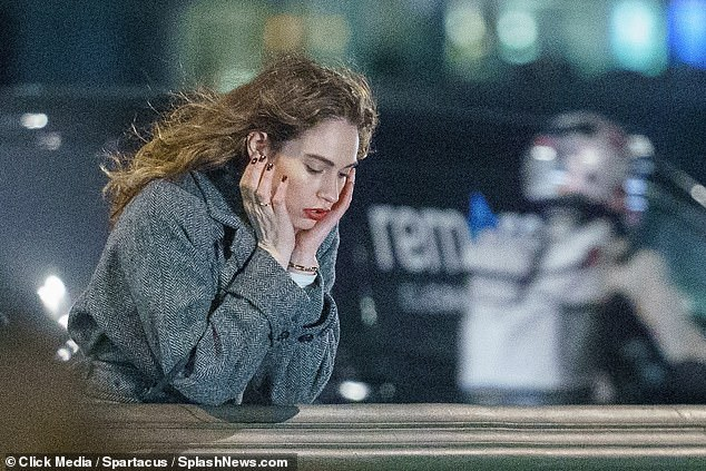 Lily James looks lovelorn on a London bridge after a dramatic year on and off the screen