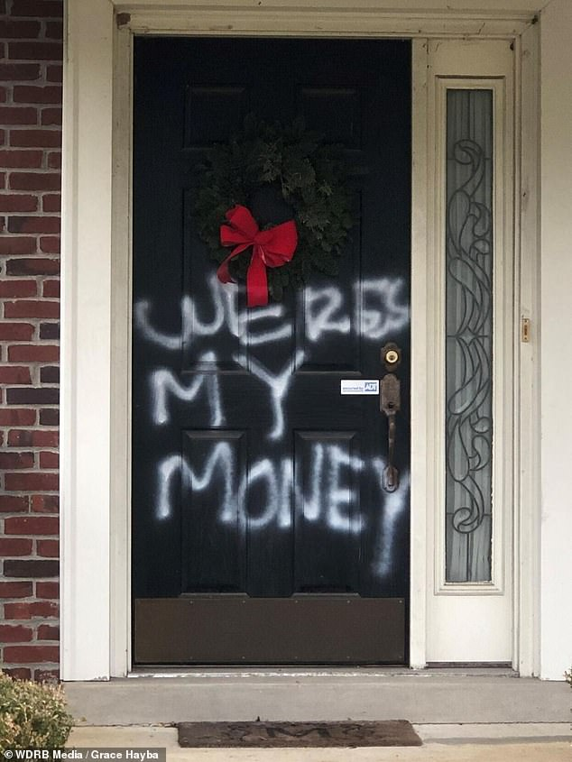 Vandals spray painted 'WERES MY MONEY' on the front door of the Louisville, Kentucky, home of Senate Majority Leader Mitch McConnell. The above image is from Saturday