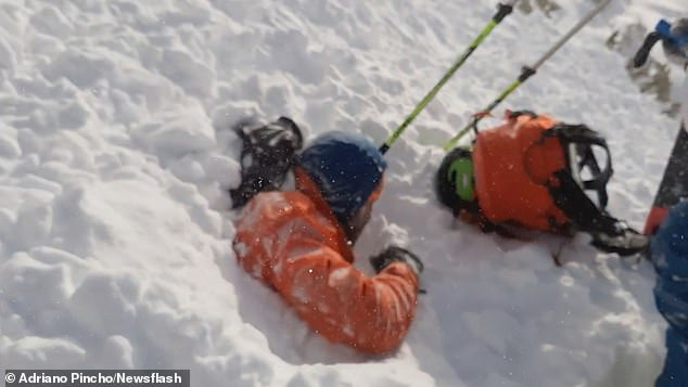 Mountaineers are surprised by avalanche that buries one up to his shoulders in Spanish Pyrenees