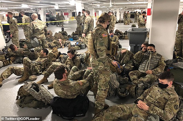 National Guardsmen are 'forced to sleep in a parking lot after being told to leave Capitol'