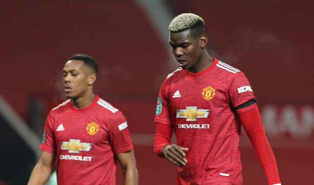 Anthony Martial and Paul Pogba of Manchester United walk off after the defeat