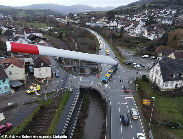 Skilled hauliers negotiate huge 220ft rotor blades through tiny villages and narrow roads