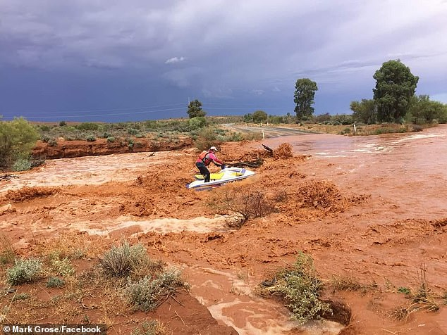 Sydney weather: Man forced to use JET SKI to get from one outback town to another due to heavy rain