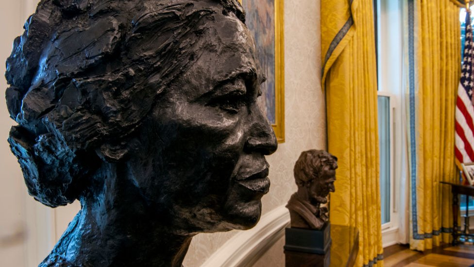 The busts of Rosa Parks and Abraham Lincoln in Biden's Oval Office.